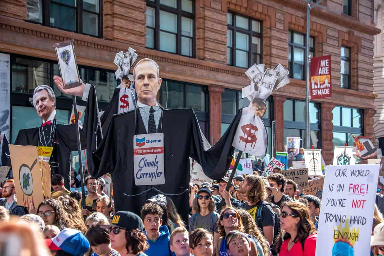 sign of Chevron executive Michael Wirth at Climate Strike March