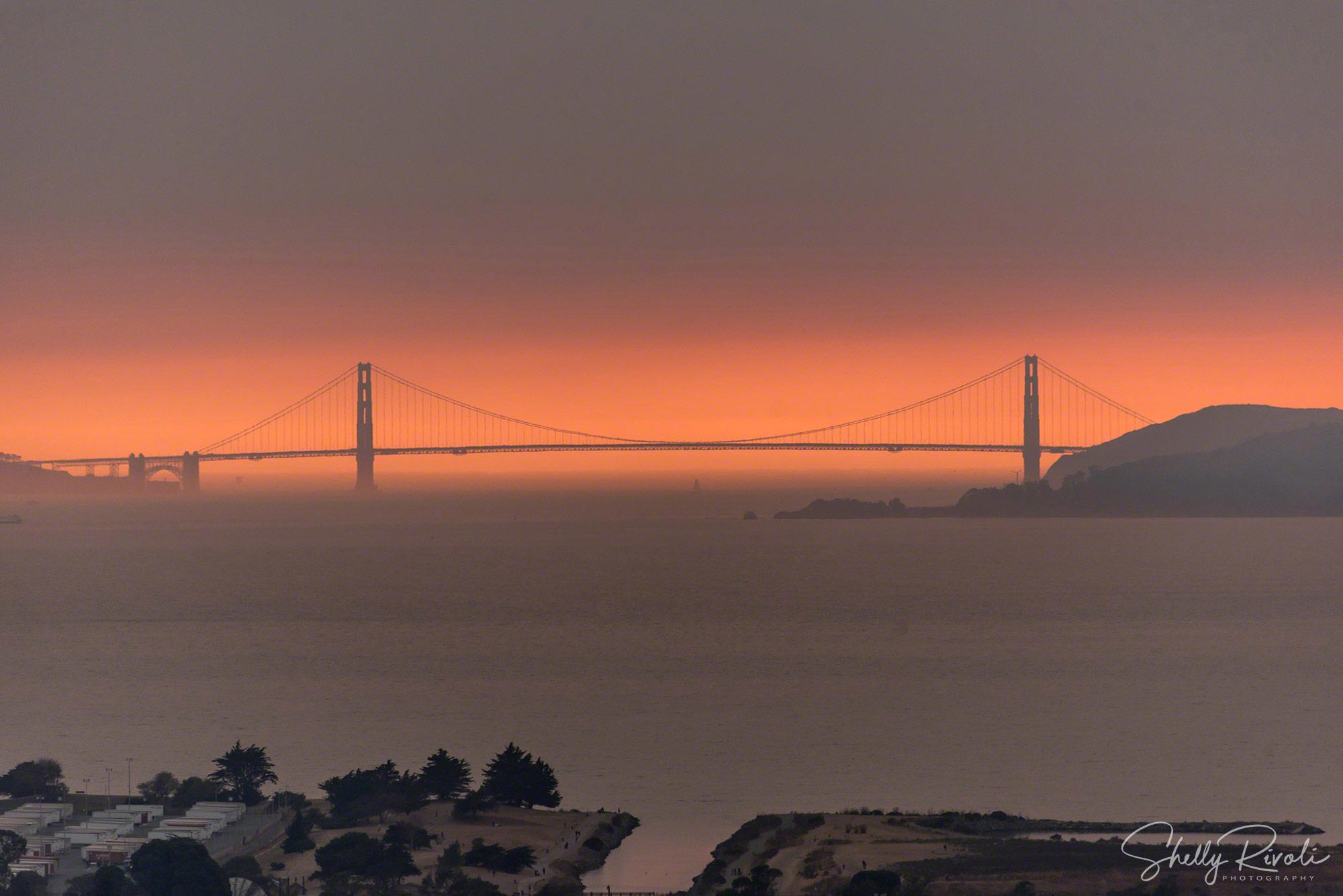 Eerie light through the Golden Gate Bridge on the evening of October 12, 2017.