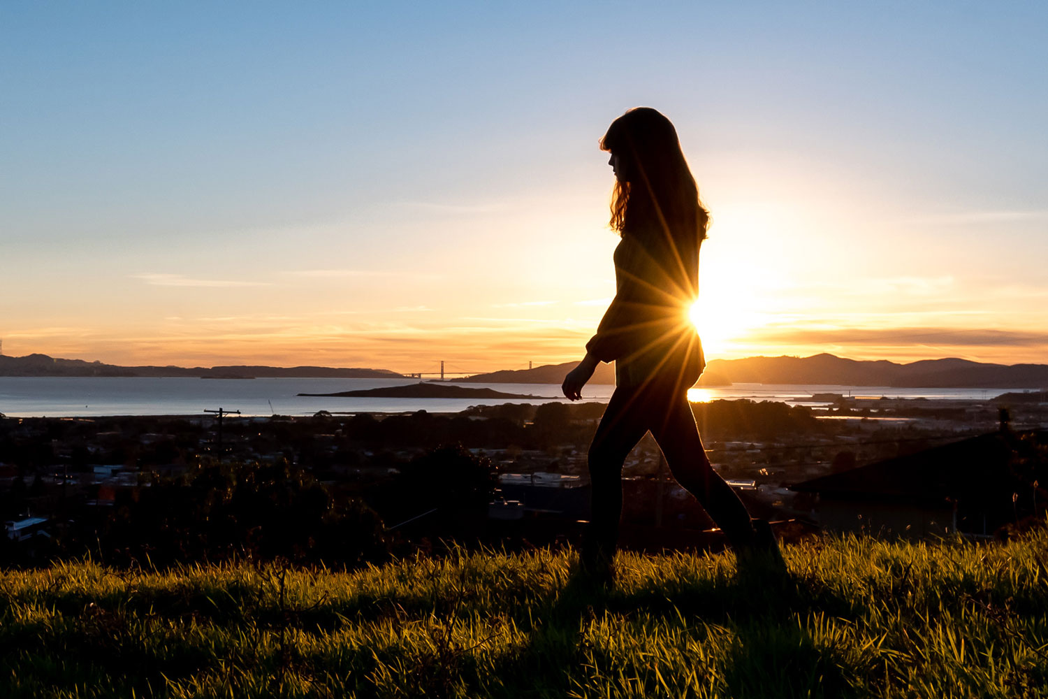 teen silhouette at sunset over San Francisco Bay