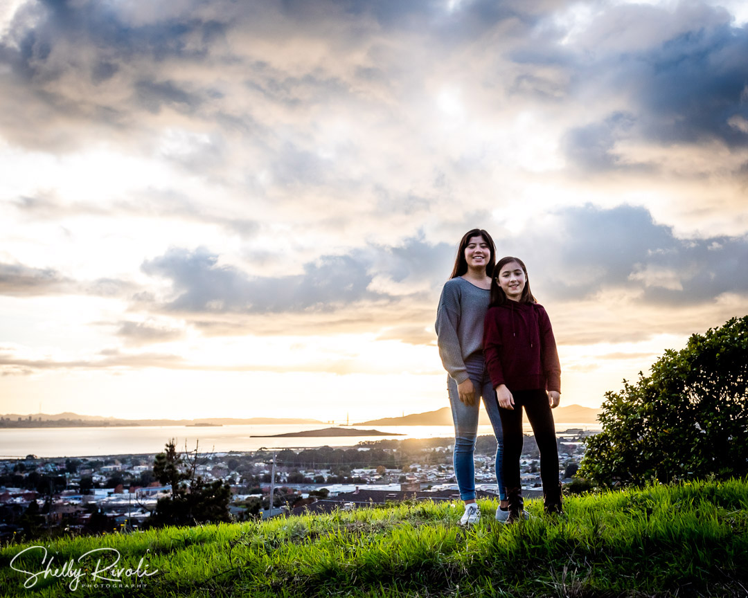 family photo of sisters with view of San Francisco Bay