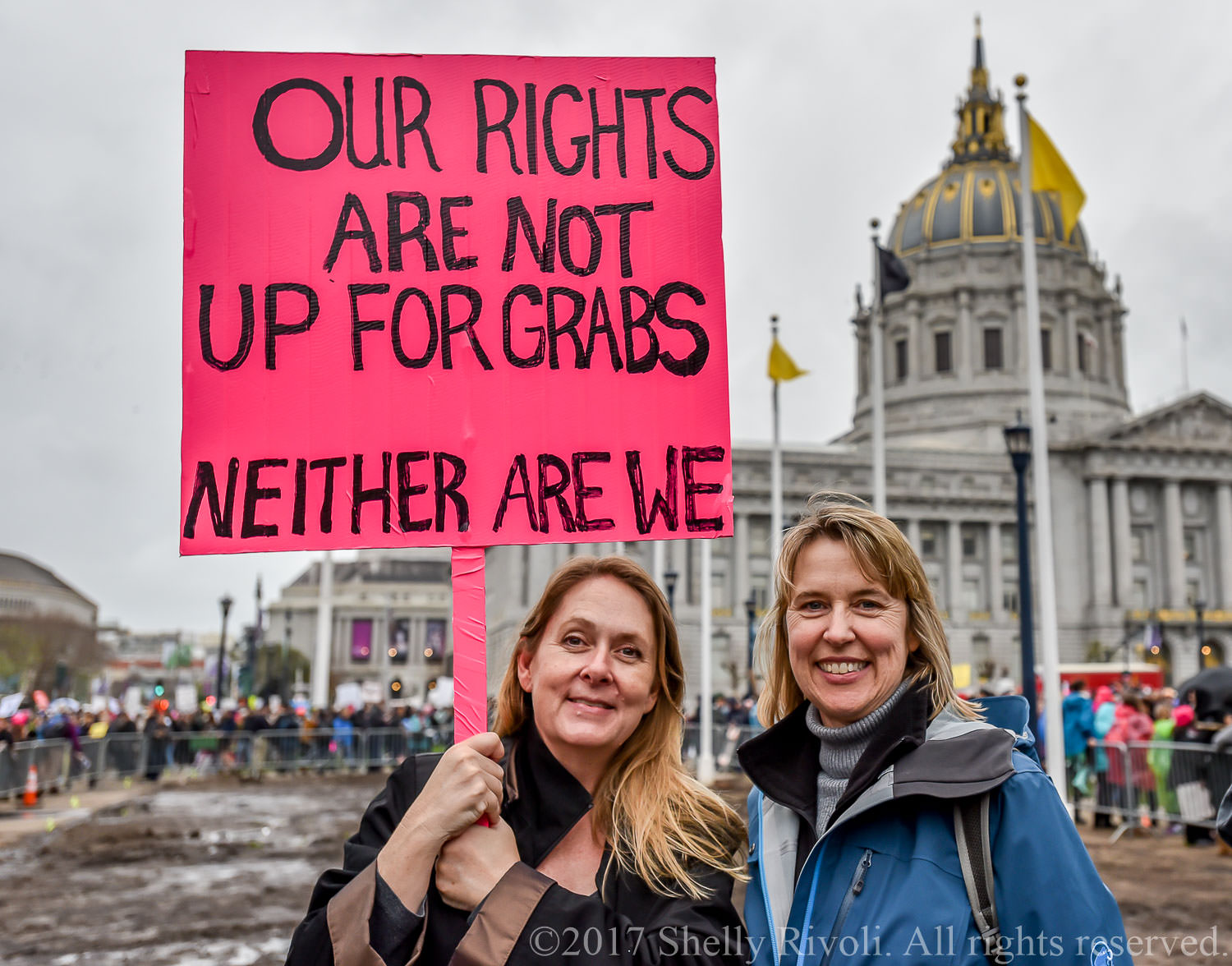 Women holding pink protest sign at 2017 Women's March San Francisco
