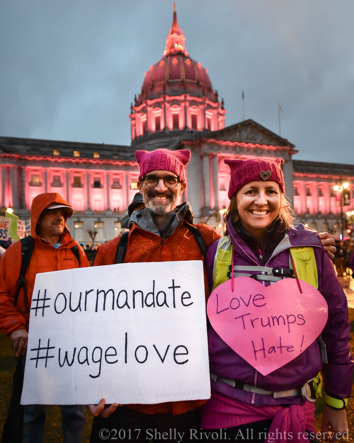 Man and woman wearing pink pussy hats at 2017 Women's March San Francisco